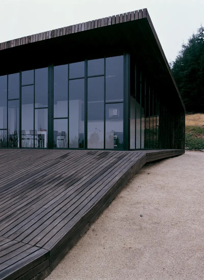 Modern Wooden House Designed Around a Deck  DigsDigs
