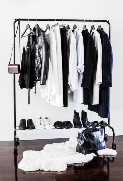 Minimalist Closets Black and White Clothing Purse Fur Rug Shoes Hanging Clothes