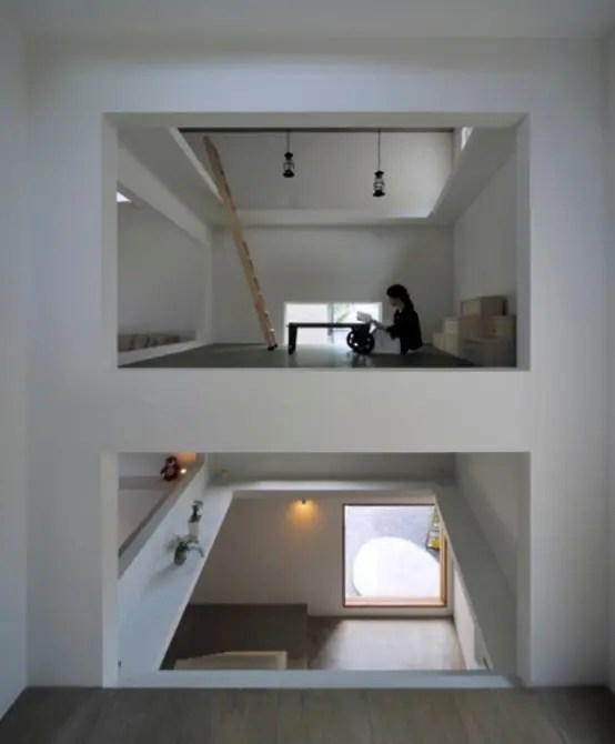 Ultra Minimalist And Thin House With Ladders Connecting