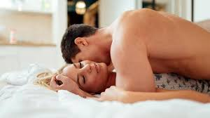 Having sexual intercourse using missionary sex position