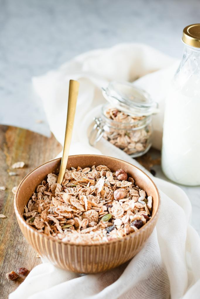 oatmeal in a brown bow and a brown spoon - What Foods Stabilize Low Blood Sugar