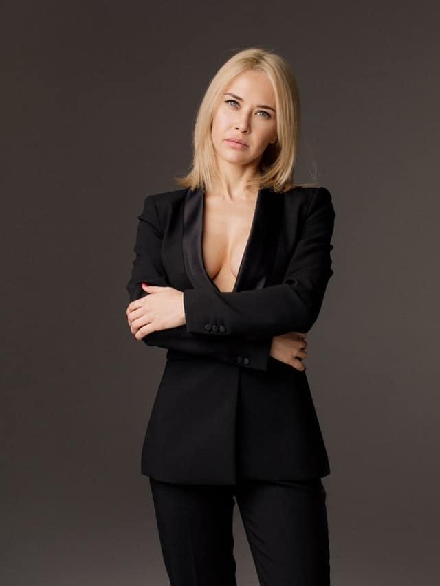 small businesswoman in black blazer standing