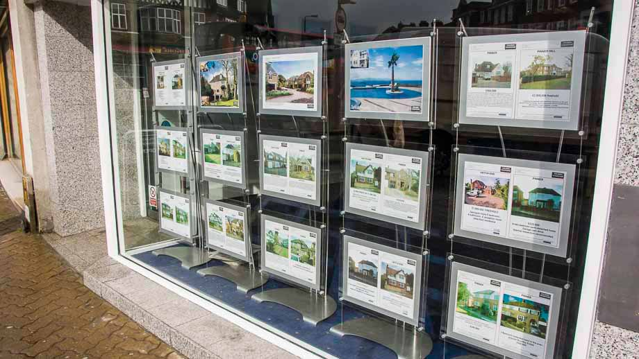Multiple A3 poster holder stands in London estate agents window display