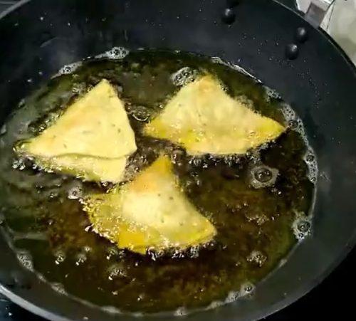Frying Punjabi Samosa