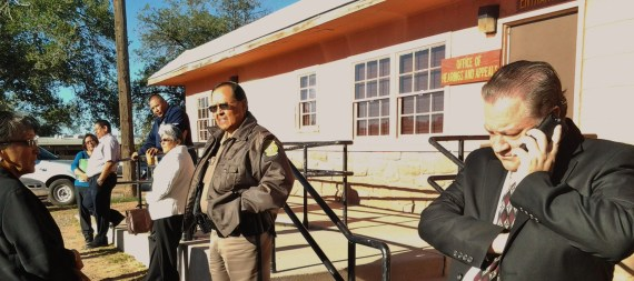 David Jordan, attorney for Navajo Nation law enforcement personnel, calls his office as he waits with his clients. Photo by Marley Shebala