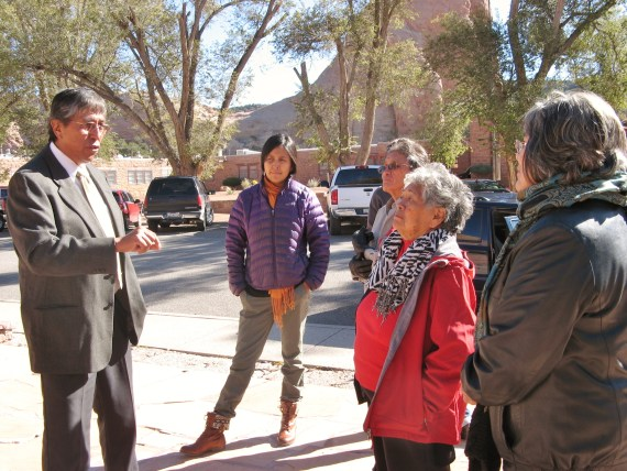Navajo Council Delegate Leonard Tsosie speaks with Dine' CARE representatives in front of the Navajo Council chamber on Oct. 16, 2013. Photo by Noel Smith