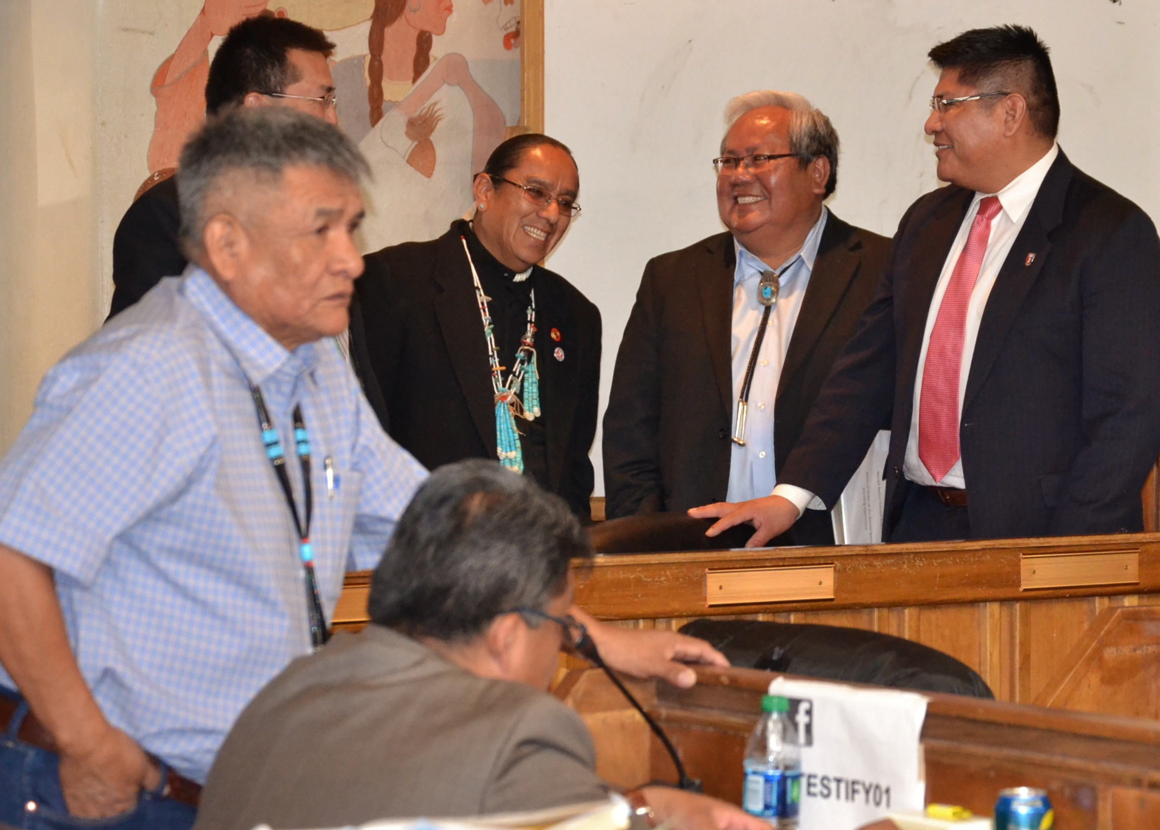 (L-) Navajo Council Delegate George Apachito stands by Delegate Edmund Yazzie during a recess in the Council's Winter session on Jan. 28, 2014 . In the background is Chief of Staff Jarvis Williams, Staff Assistant Darrell Tso Sr., Speaker Johnny Naize and Staff Assistant Ansley Curley. Photo by Marley Shebala