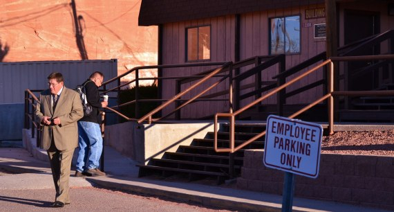 (L-R) Navajo Council Interim Speaker Pro Temp Delegate LoRenzo Bates had to telephone tribal maintenance office for assistance to open the front door of the Office of the Speaker in Window Rock, Ariz., at about 7:30 a.m. on April 7, 2014. Someone had jammed a metal paper clip into the door lock.  As Bates waited for the maintenance person, legislative staff arrived for work. Photo by Marley Shebala