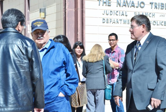 (L-R Forefront) Navajo Council Delegate Russell Begaye talks with Delegate Charles Damon II as Speaker Pro Temp Delegate LoRenzo Bates begins walking towards them after a hearing at the Window Rock District Court on Speaker Naize's request for a temporary restraining order against 12 delegates and one employee on April 8, 2014. Photo by Marley Shebala