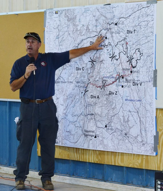"Southwest Incident Management Team 3 Liaison Ben Fisk had SWIMT 3 Operations Chief Trainee Dave Gesser announce that the Assayii Lake Fire was 60 percent contained and that Narbona Pass was opened at the SWIMT 3 daily morning fire update at the Tse Hootso Middle School ""Tin Building"" in Fort Defiance, Ariz., on June 22, 2014. Photo by Marley Shebala (Please credit if reusing photo.)"