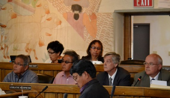 Navajo Nation legislative staff sit behind Navajo Agricultural Products Industry General Manager Tsosie Lewis, Board Vice Chairperson Irvin Chavez, private attorney Paul Frye, and Washington D.C., lobbyist Paul Moorehead as NAPI reports on outstanding issues related to incomplete tribal farm during Naabik'iyati Committee meeting at Council chambers on July 10, 2014. Sitting in front of NAPI is Navajo Council Delegate Walter Phelps. Photo by Marley Shebala. (Please provide proper photo credit when reusing photo.)