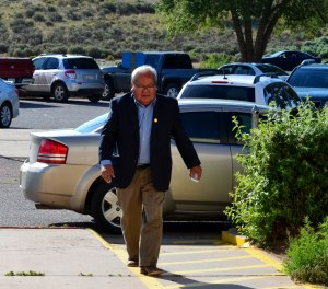 Navajo Council Speaker Johnny Naize arrives at the Navajo Nation Window Rock, Ariz., District Court for a July 18, 2014, hearing on a motion by Navajo Nation Special Prosecutor to hold his trial with current Delegate David Tom and former Delegates George Arthur,  Photo by Marley Shebala. (Please provide proper photo credit when reusing photo.)Leonard Teller and Ernest Yazzie.