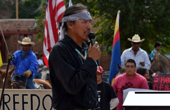 "Leland Grass, Dine' traditionalist, in front of the Navajo Council chamber on July 21, 2014, as part of a group of horseback riders from across the Navajo Reservation that opposed horse roundups and proposed range land management laws. Grass presented on ""Save the Navajo horse"" with several other individuals during the Navajo Nation horse conference at the Twin Arrows Casino & Resort on Aug. 16, 2014. Photo by Marley Shebala. (Please provide proper photo credit when reusing photo.)"