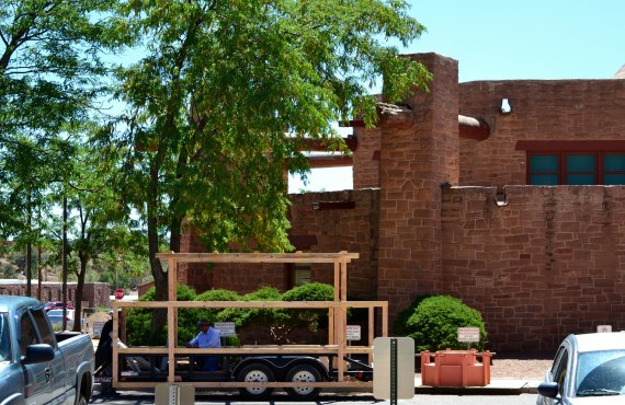 A parade float for the Navajo Nation Council to enter into the Navajo Nation Fair parade on Sept. 6, 2014, is being built on the north side of the Council chamber in Window Rock, Ariz., on Sept. 3, 2014. A part of the float is a miniature Council chamber, which sits by the float. (Photo by Marley Shebala. Please give proper credit when re-using.)