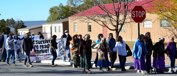 Navajo elders from Big Mountain, Ariz., and Black Mesa, Ariz., lead a peaceful walk from Window Rock Mini-Mall to the Navajo Nation Council chambers in Window Rock, Ariz., on Oct. 30, 2014, to protest impoundment of their livestock and arrest of Navajo people by Hopi Tribal police and U.S. Interior Department Bureau of Indian Affairs rangers. (Photo by Marley Shebala. Please provide proper credit when re-using.)