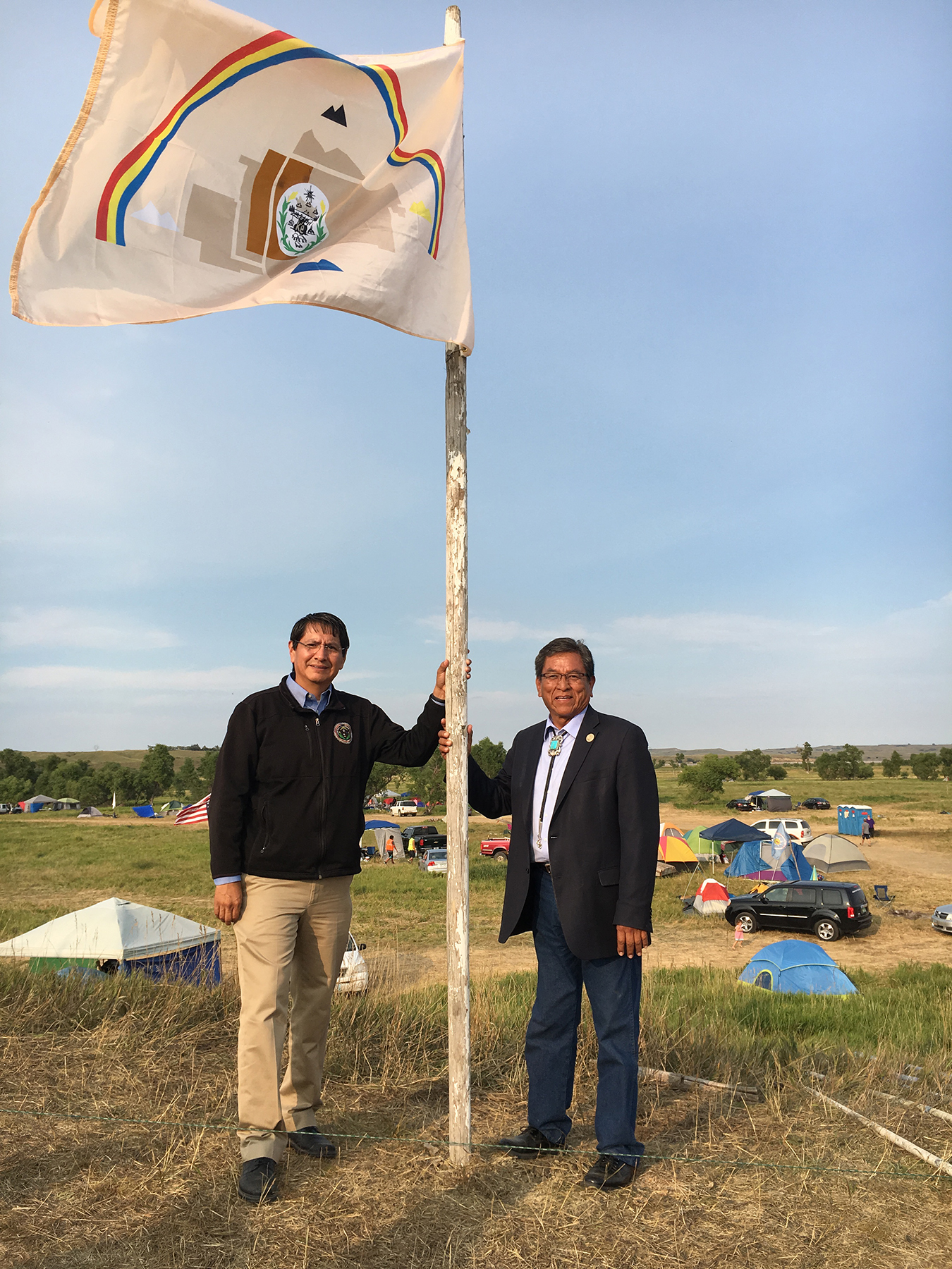 Navajo Nation President Russell Begaye and Vice President Jonathan Nez raise the Navajo Nation flag at the Sacred Stone Camp in Cannon Ball, N.D. in August 2016. Courtesay photo