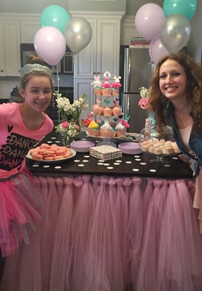 Curlylocks and mini Mimi with tutu wrapped dessert table loaded with treats