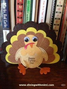 Felt turkey in front of cookbooks Turkey Pairing Southern Side Dish www.diningwithmimi.com