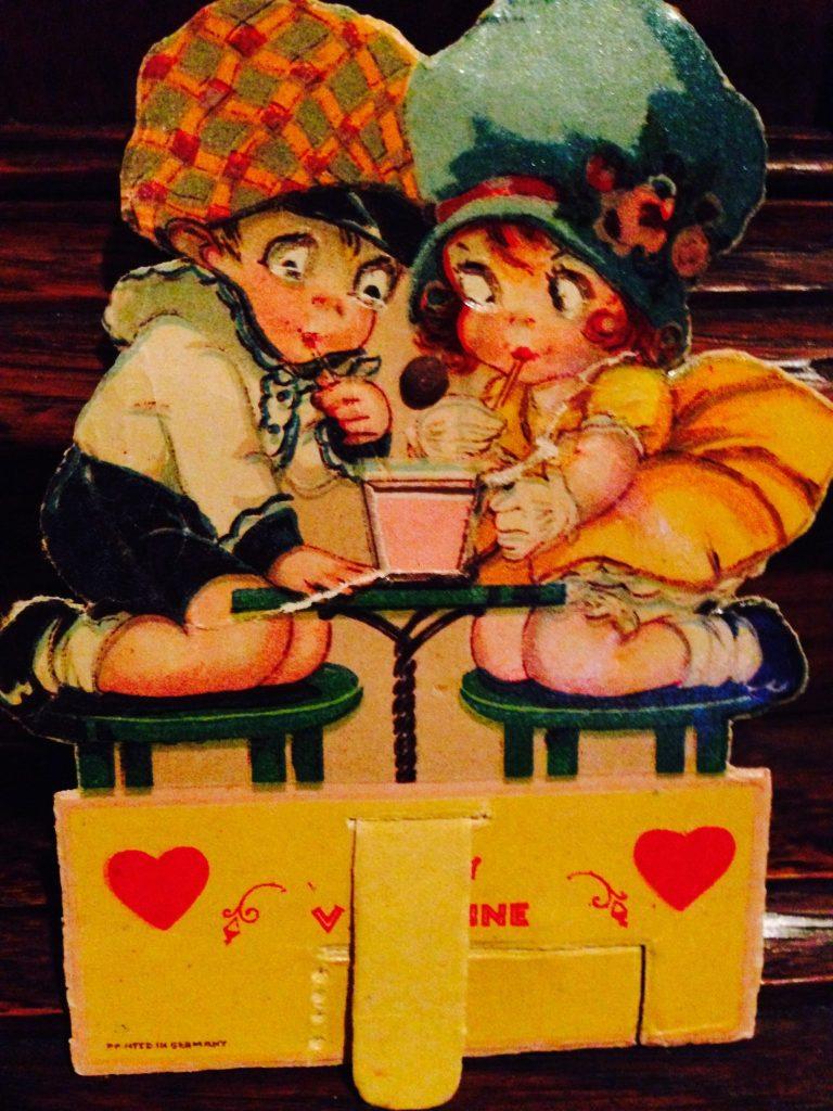 Vintage Valentine of boy and girl sharing a soda www.diningwithmimi.com