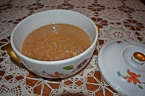 Dish of vension cutlets with gravy www.diningwithmimi.com