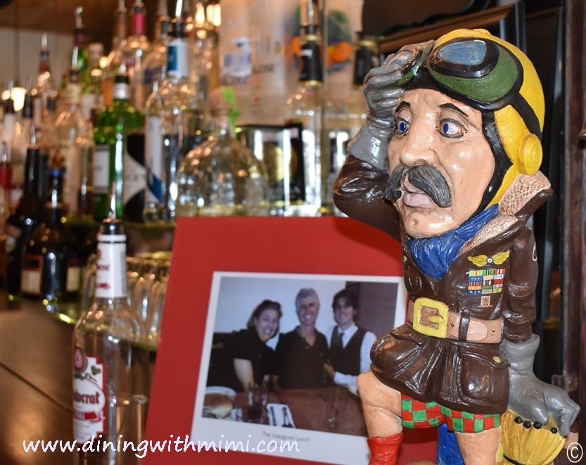 Bar scene with liquor bottles and Aviator Rural Alabamam Trip to Inspire www.diningwithmimi.com