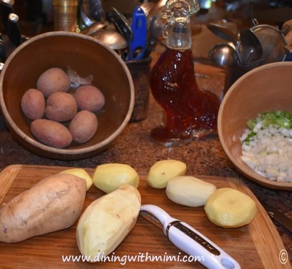 Potatoes on cutting board for Save a Ham Bone, Feed a Cowboy Soup Recipe www.diningwithmimi.com