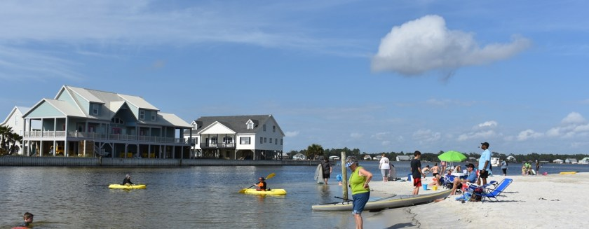 Beach view with sunbathers, kayaks, and Mimi's Celebrate Summer Menu Before It Disappears www.diningwithmimi.com