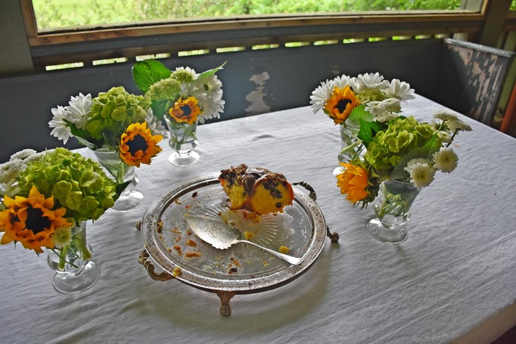 Cake Plate with slice of Mimi's Never Fail Spirited Blueberry Bundt Cake www.diningwithmimi.com