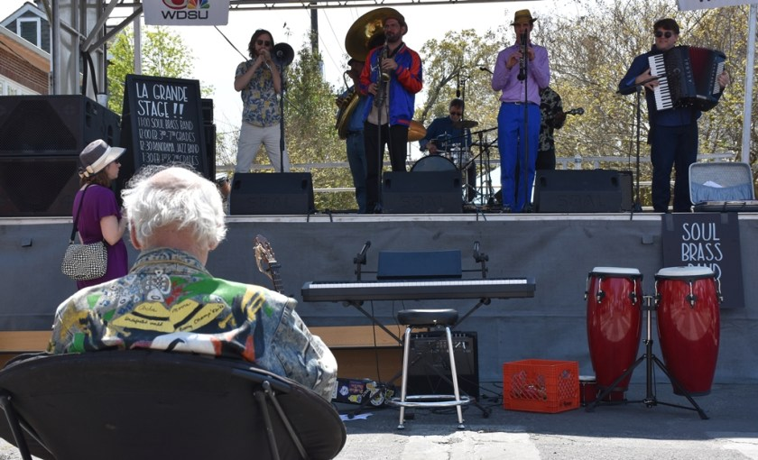 5 piece Band playing on stage in front of seated fan Need a quickie- Drop into New Orleans for 48 hours www.diningwithmimi.com