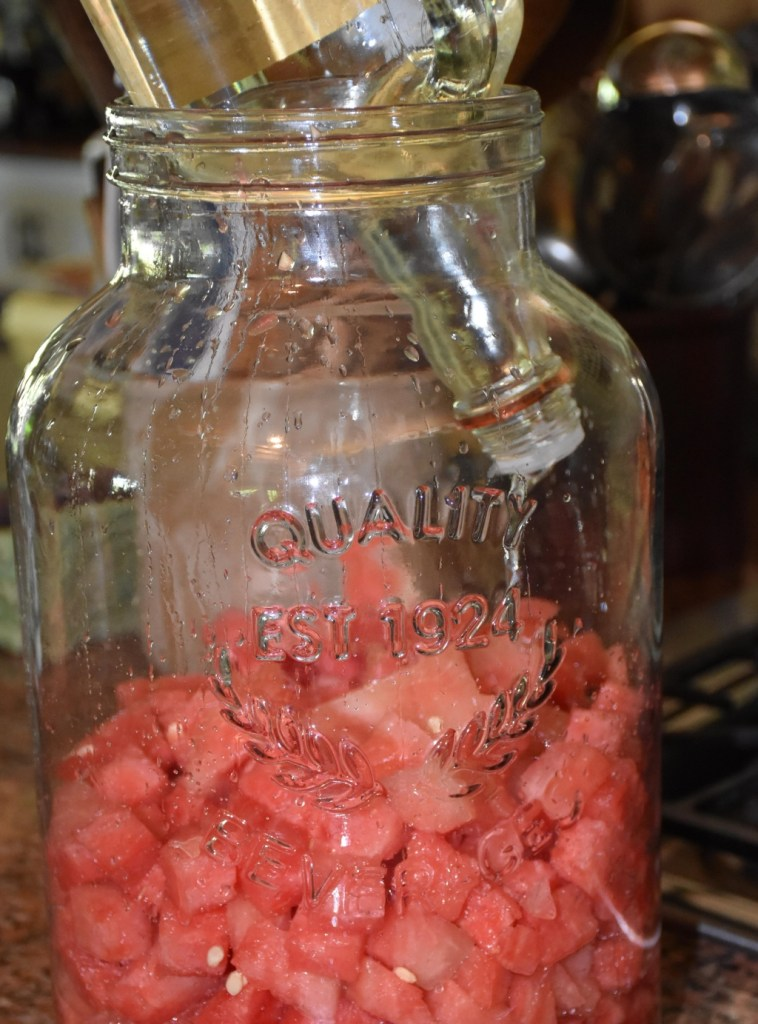 Vokda over Watermelon waiting in 5 gallon dispenser www.diningwithmimi.com