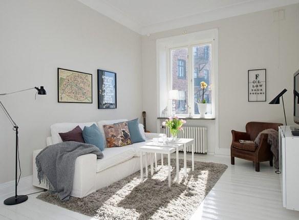 salón con sofá blanco estilo moderno
