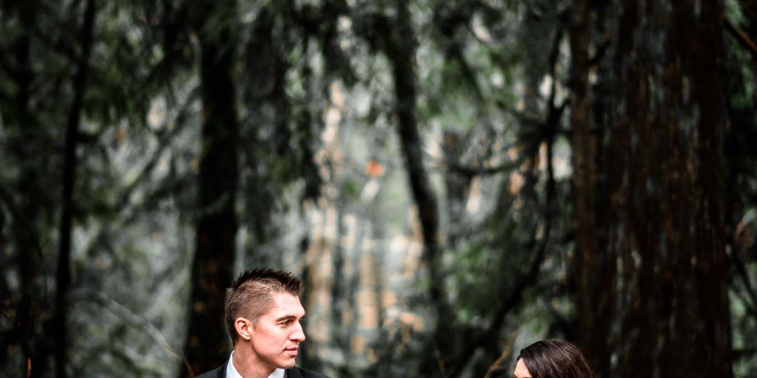 Bride and groom standing next to each other in the woods at the Burke Cabin in Mt. Hood Oregon