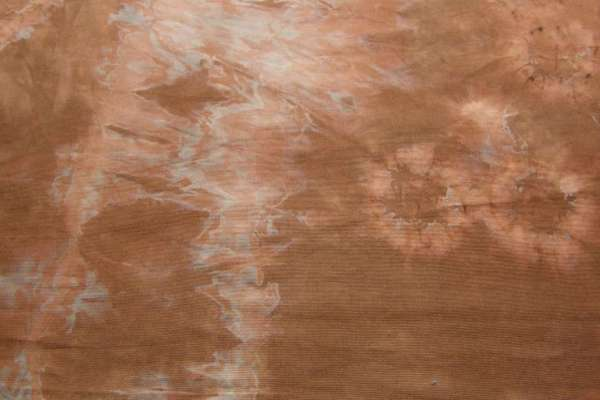 Discharged brown-orange shibori