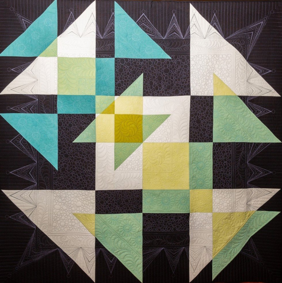 Lisa's award-winning Transparent Shoo-fly quilt, quilted by Amy Mikeska