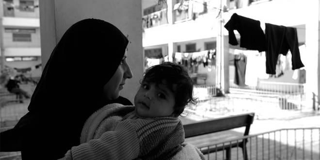 Mujer palestina refugiada en un albergue de la UNRWA. Foto: UNRWA/Shareef Sarhan