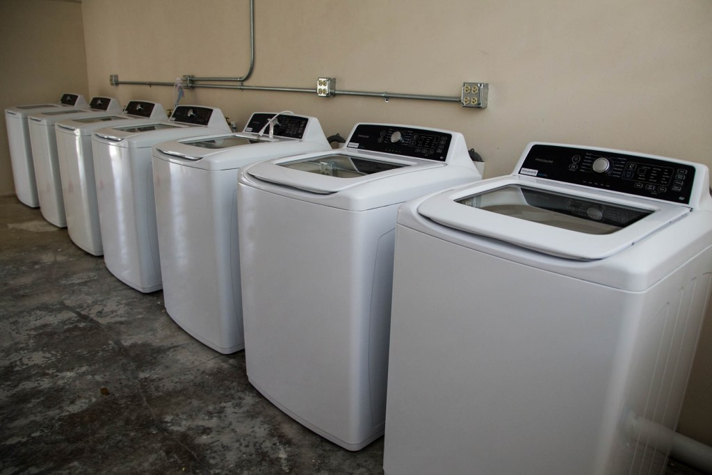 A brand new solar-powered laundry room at the non-profit Acción Comunitaria del Viví, Inc., in Barrio Vivi Arriba, Utuado, Puerto Rico, on May 26, 2018. Inside the former public school, the group, funded by Direct Relief, opened a free laundry service for the two nearby communities who have been without power for over eight months. The group, coordinated by Miguel Morales, serves as a community and aid center in the aftermath of Hurricane Maria. Many of the residents of the mountainous area are elderly and underprivileged. (Photo by Erika P. Rodríguez for Direct Relief)