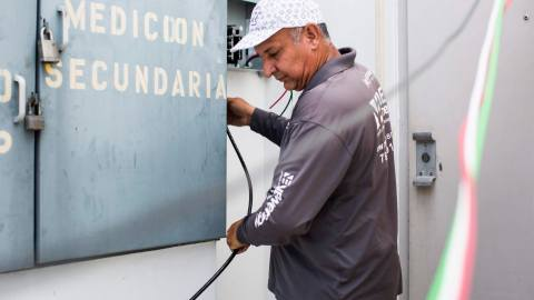 Noel Torres, installs a solar power system at Clínica Iella in San Juan, P.R., on July 5, 2018. Torres works with renewal power systems in the island and has seen more work after hurricane Maria struck in September of last year, and left the American territory in the dark. The clinic's new solar system, funded by Direct Relief, will help them maintain their medication if there's power interruption. Torres, from Aguadilla, worked for months installing solar panels while not having power for his family at home. (Erika P. Rodriguez/Direct Relief)