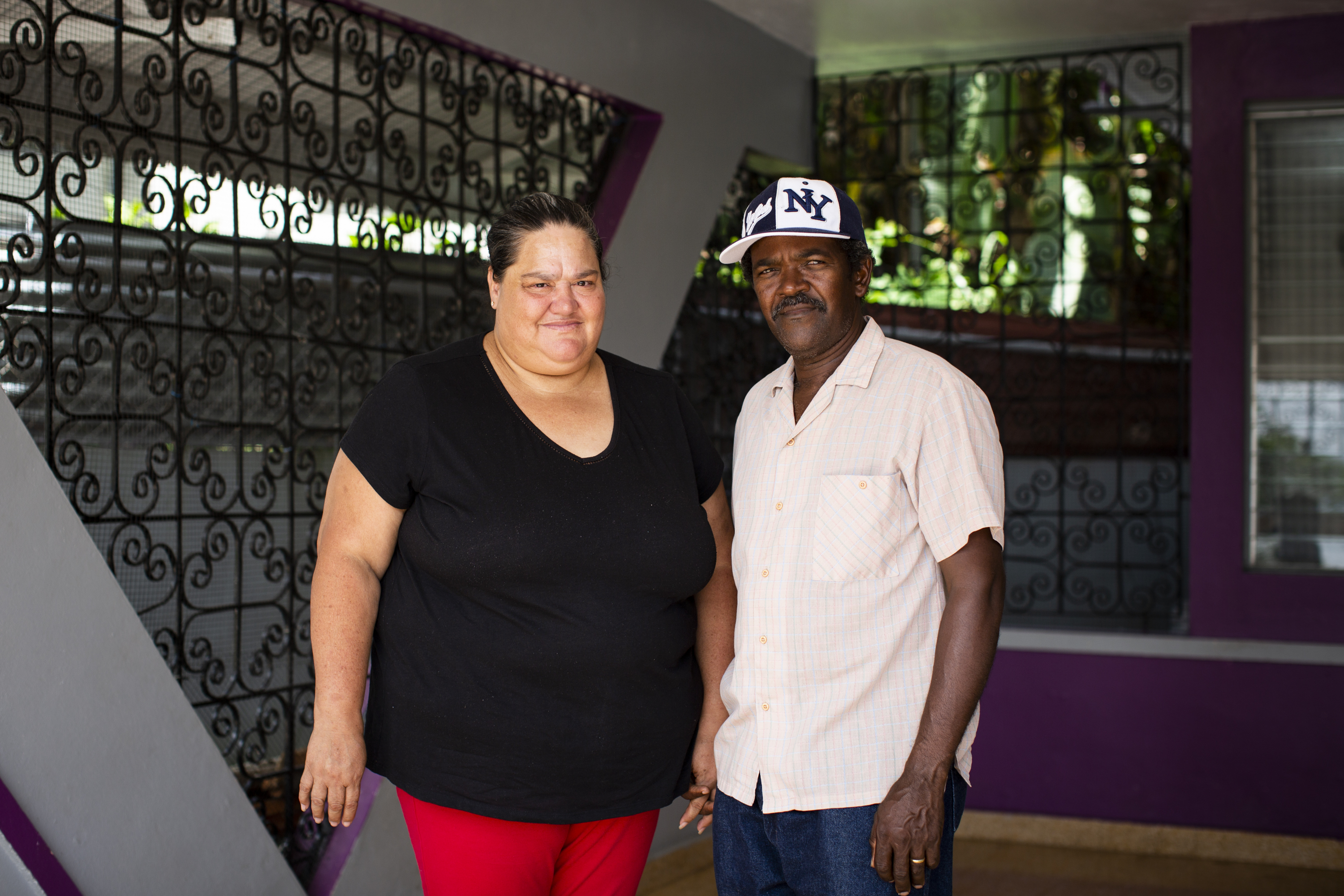 From left, Nilda Valentín, 53, and Rosario Jiménez, 55, pose for a portrait at their home in Las Marias, P.R., on September 11, 2018. The couple, who receives health care at the Migrant Health Center in town, suffered damage in the second floor of their home and have find it hard to make ends meet when the renters left. (Erika P. Rodriguez for Direct Relief)