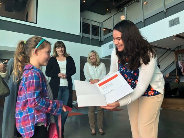 Mae Pesendian receives a certificate of appreciation from Direct Relief staff on Tuesday, January 22. (Bryn Blanks/Direct Relief)