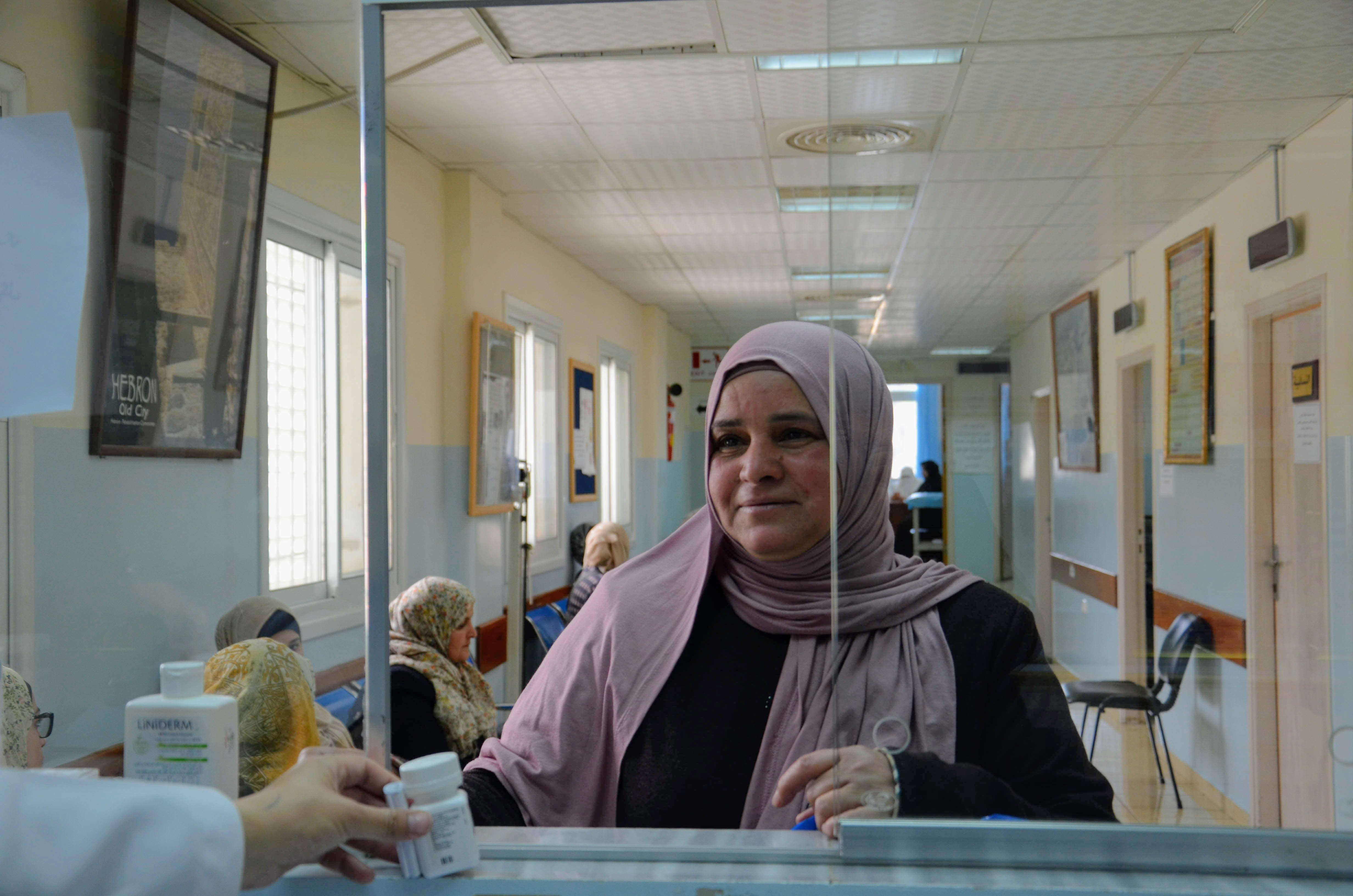 Paient receives medicine for diabetes management at Hebron Charitable Clinic in Palestine. (Photo courtesy of Anera)