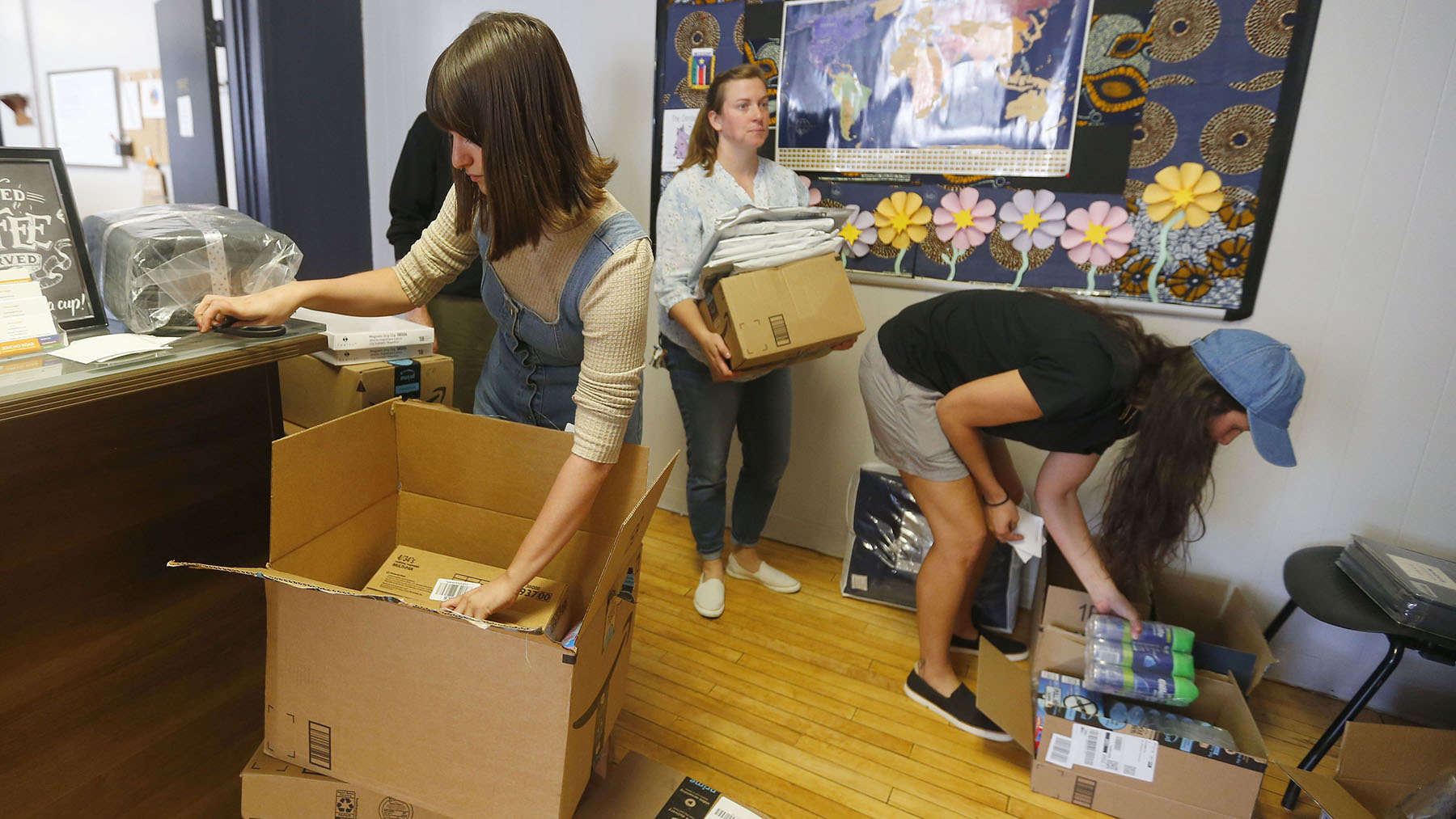 Vive Shelter staff unpack boxes of supplies at the Buffalo shelter, operated by local health center, Jericho Road, which has stepped up to provide services, including for health needs. (Mark Mulville/Buffalo News)
