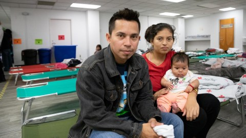 A family sits in the shelter's sleeping area. Families staying at the shelter receive food, clothing, medical care, and legal advice. (Photo courtesy of Jewish Family Service of San Diego.)