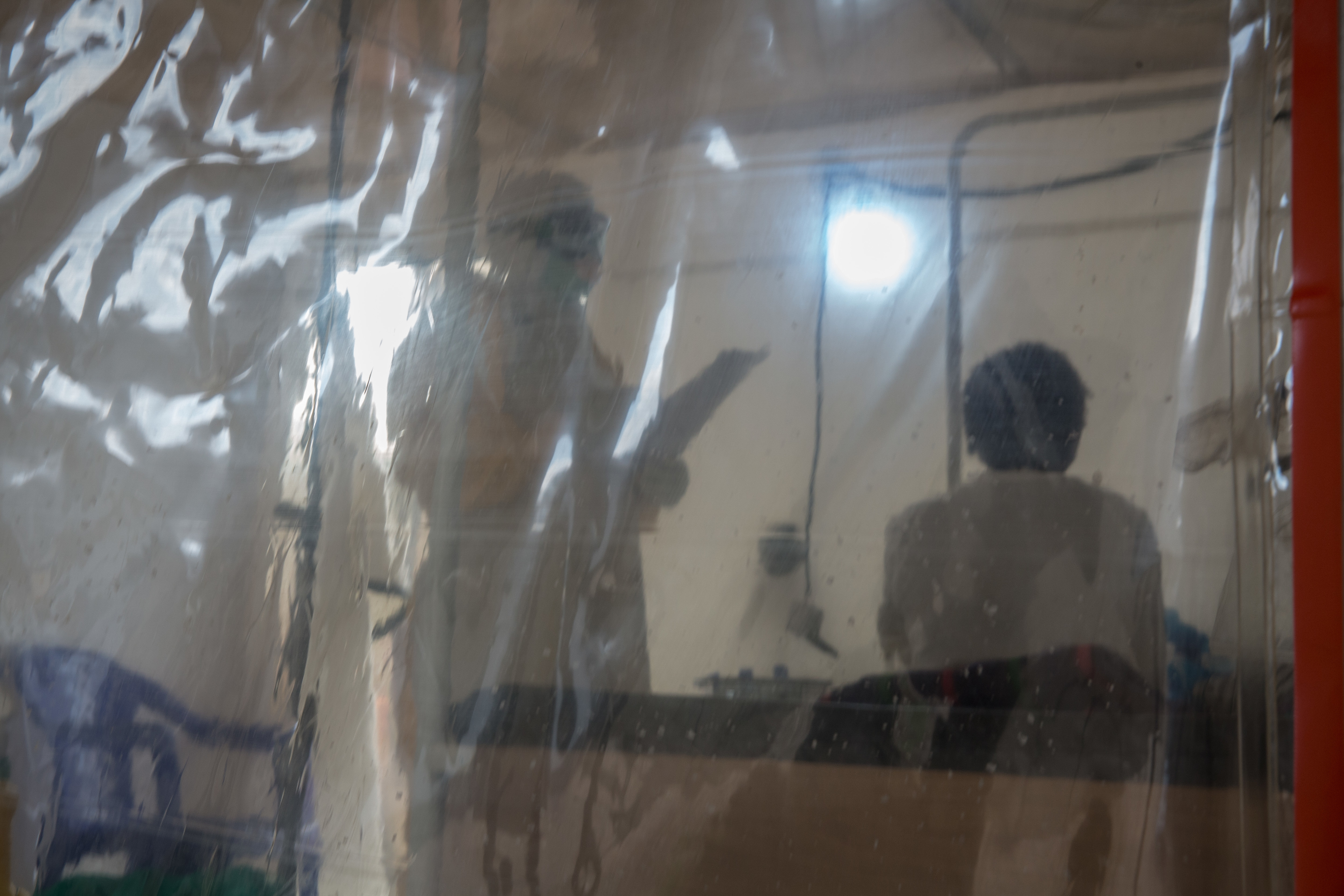 BENI, DEMOCRATIC REPUBLIC OF CONGO - A doctor wearing full protective gear speaks to a patient in the Ebola treatment centre in Beni, eastern Democratic Republic of the Congo.The DRC is currently experiencing the second worst Ebola outbreak in recorded history. (Photo by Sally Hayden/SOPA Images/LightRocket via Getty Images)