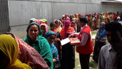 Female patients wait in line on July 25 at a HOPE Foundation pop-up emergency medical camp in Sirajgaag , a flood effected area in Bangladesh.