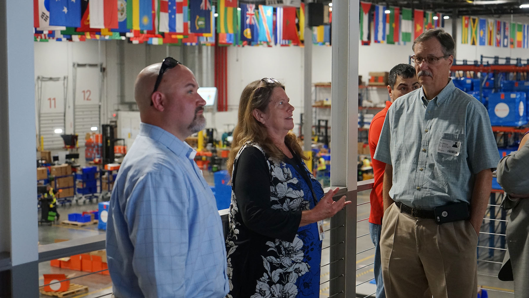 Direct Relief Pharmacist Ruth Smarinsky briefs state officials in Direct Relief's warehouse Wednesday. (Tony Morain/Direct Relief)