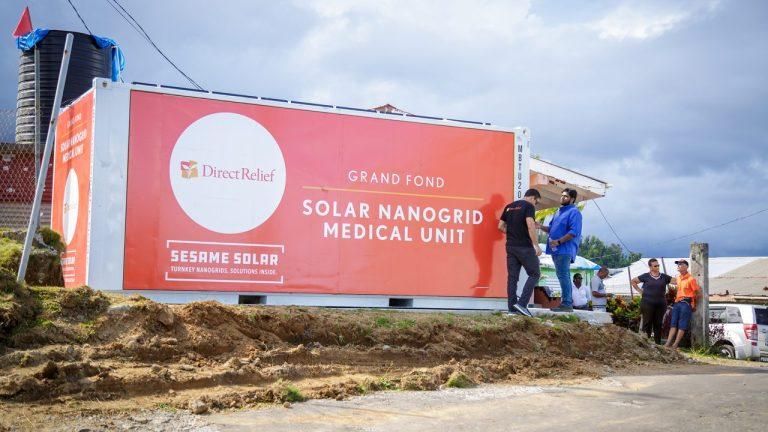 A solar nanogrid is unveiled in Grand Fond, Dominica, on Oct. 4, 2019. The nanogrid provides emergency power, water purification and refrigerated storage for medicines like vaccines. (Photo by Chad Ambo for Direct Relief)