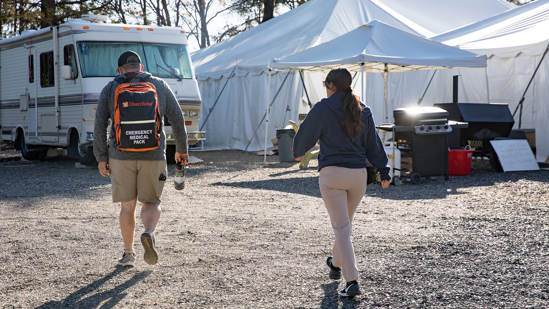 Paramedic Sean Biswun and another volunteer head toward a nearby parking lot where Camp Fire survivors are staying in RVs. (Mark Semegen for Direct Relief)