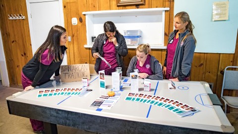 Volunteers distribute Narcan, a naloxone nasal spray, at a Butte County mobile clinic run by the group Medspire. Steve Caput, a former Butte County paramedic, noticed a significant increase in opioid overdoses in the wake of the Camp Fire. (Photo by Mark Semegen for Direct Relief)