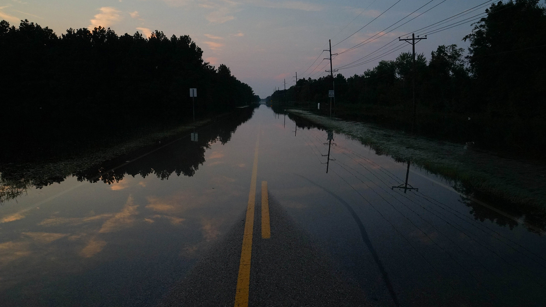 A road obscured by the floodwaters near Beaumont, Texas. (Lara Cooper/Direct Relief photo)