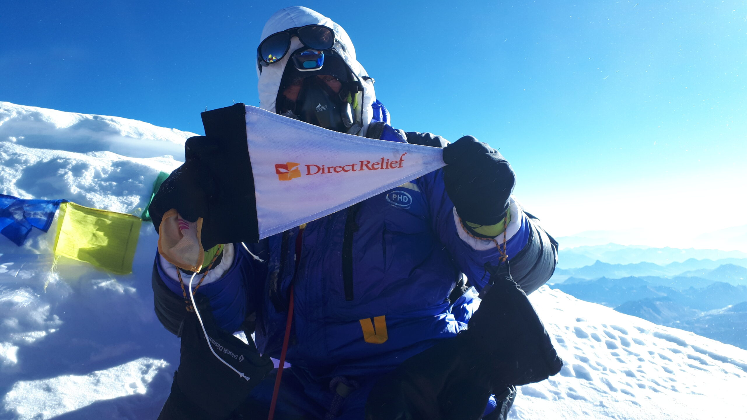 DHL's Roland Thomas atop Mt. Everest, during his trek to support Direct Relief